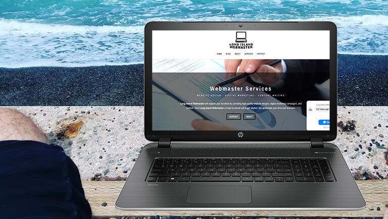 Greg Grigorian on the beach working on websites.